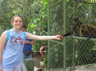 Photo of the author making a connection (with a monkey) in Costa Rica