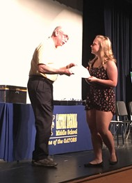 Kylie LaMora accepts Hart Leadership Scholarship (photo)