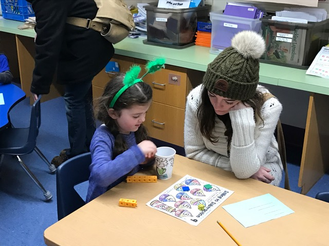Photo of parents, children at Math Family Game Night