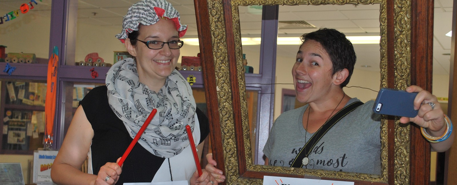 Our music teacher Mrs. Mosher (left) and our art teacher (Ms. Thornton-right)  showing their style for vocabulary day.